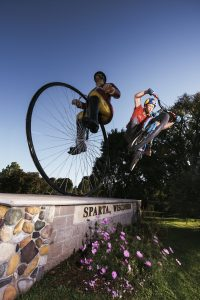 Watch Cyclists Jump Over Random Statues Because Sparta Wisconsin is the Bike Capital of the World
